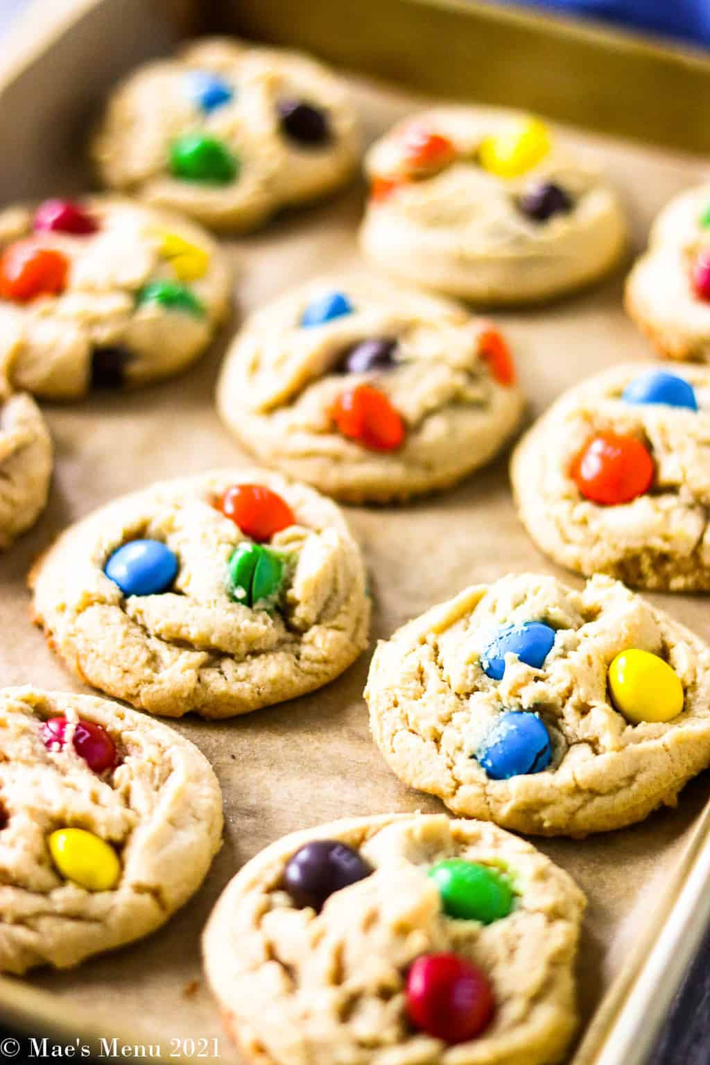 A side angled shot of a tray of peanut butter M&M cookies