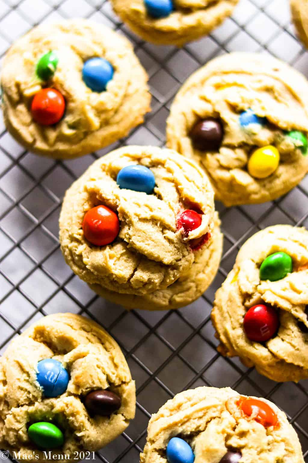 Peanut butter M&M cookies on a cooling rack