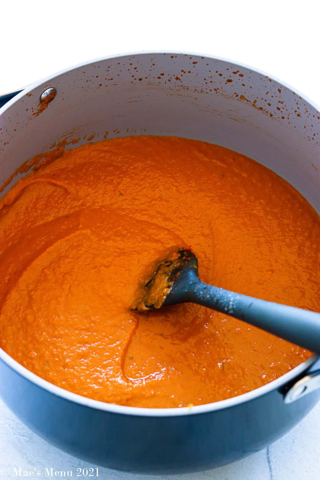 A Dutch oven of pumpkin pasta sauce