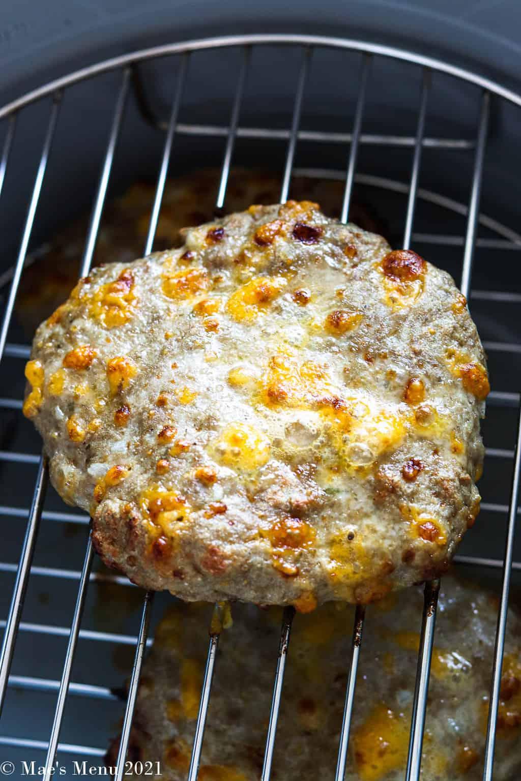 An air fried turkey burger on an air frying rack