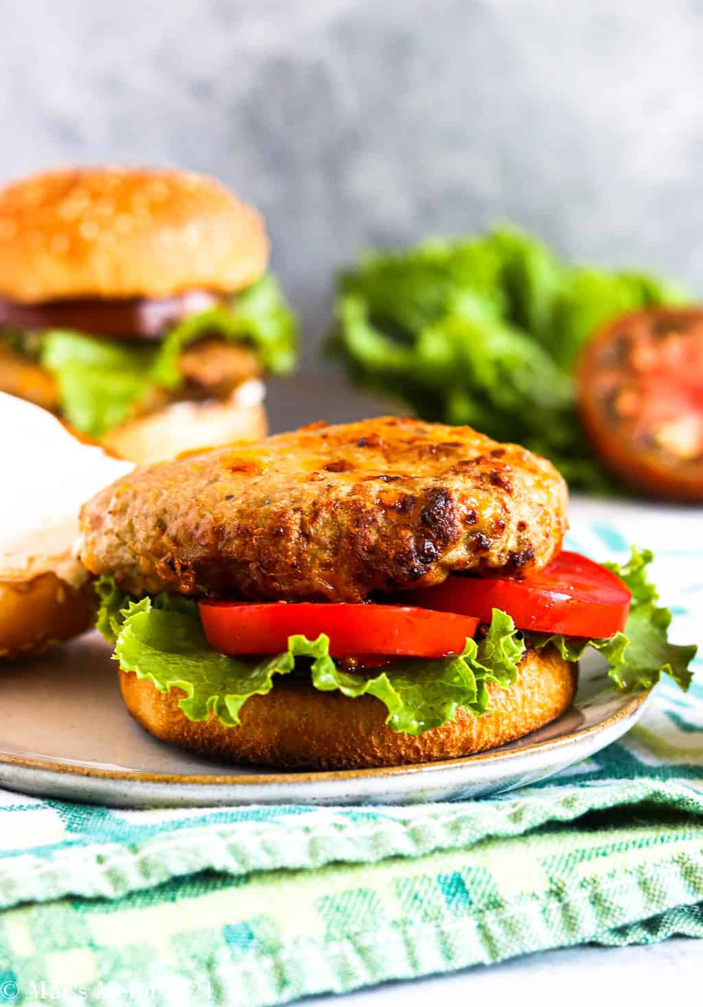 An air fryer turkey burger on a bun with lettuce and tomato