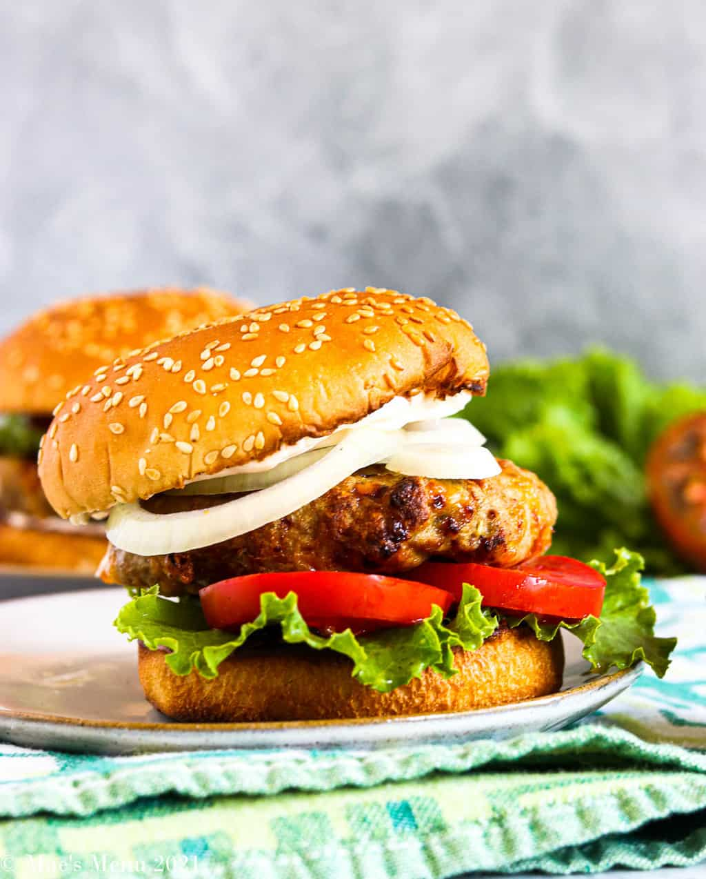 a side shot of a plate of air fryer turkey burgers