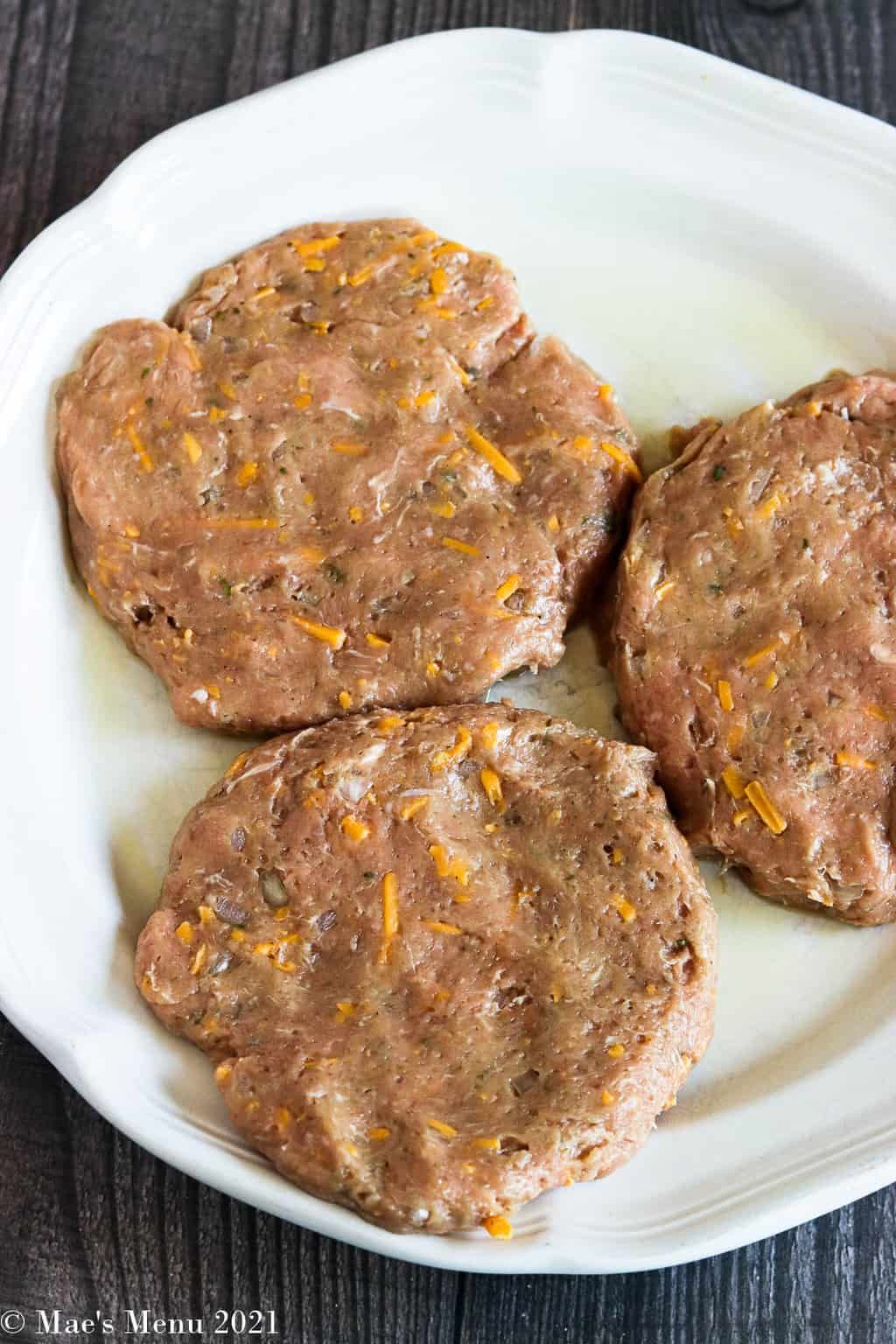 Turkey burger patties on a white dinner plate