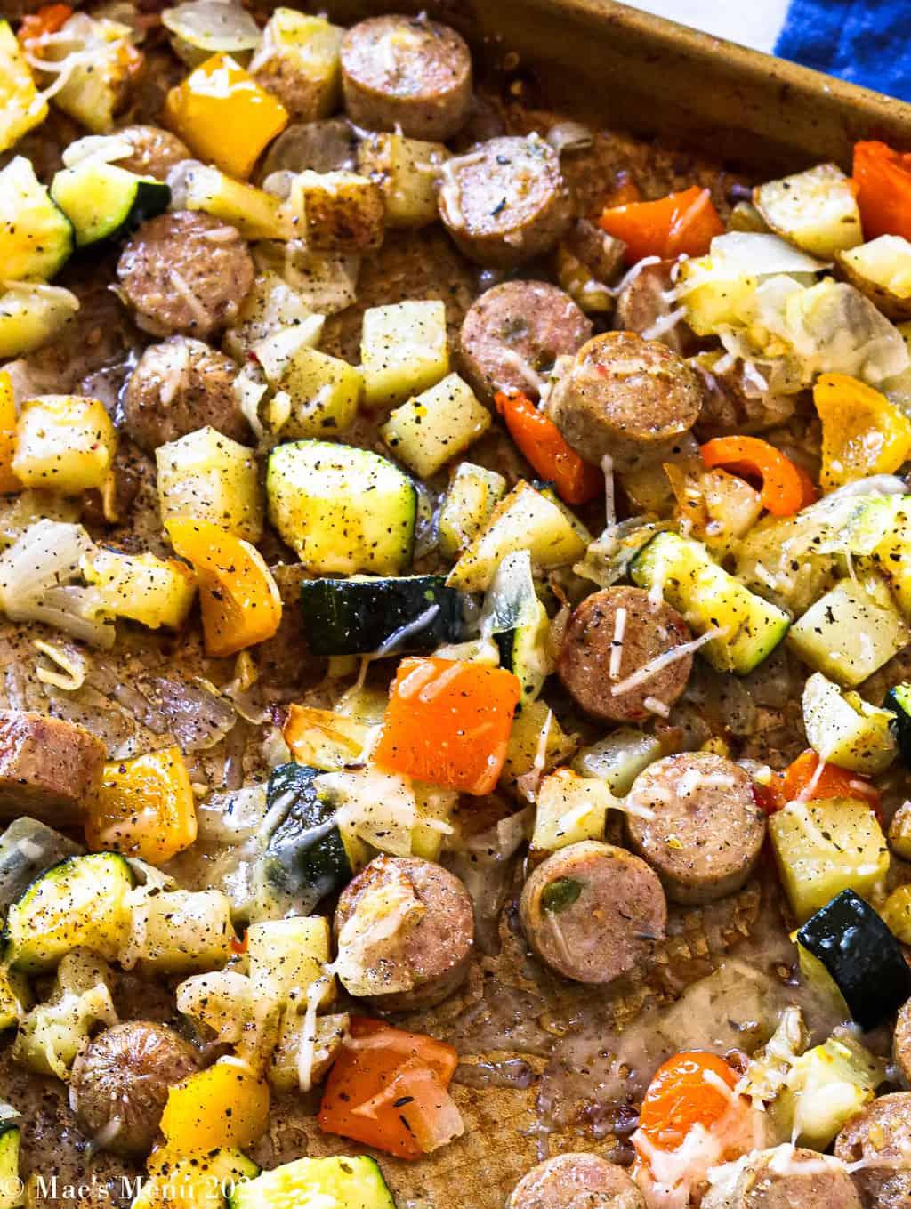 An up-close shot of the sheet pan sausage and veggies