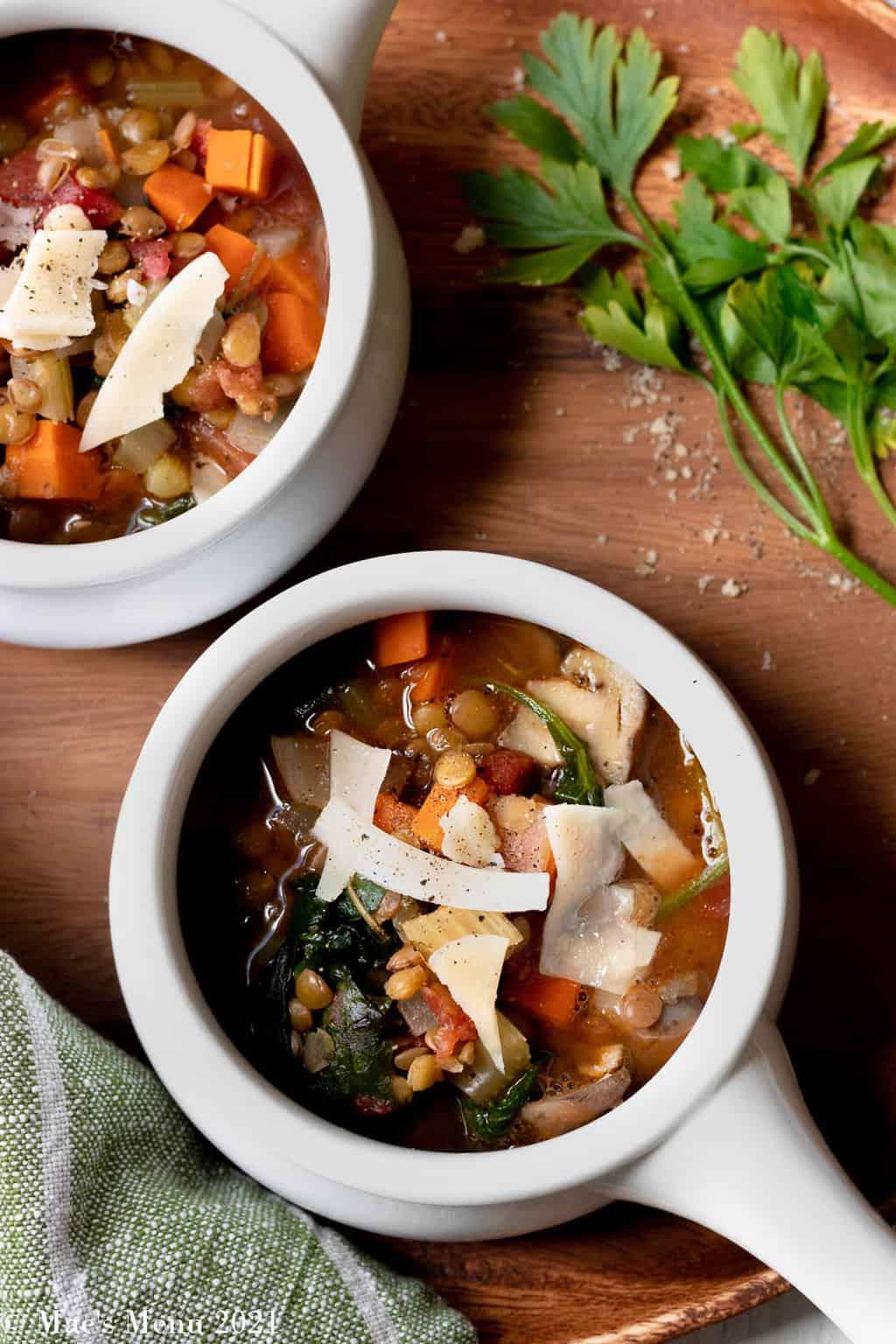 An overhead shot of wo bowls of Italian lentil soup
